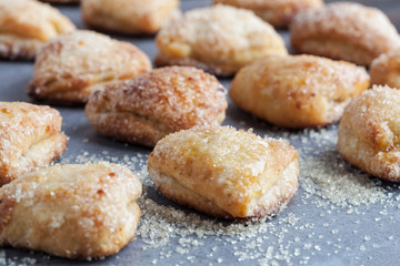 Rows of cottage cheese cookies covered in sugar. Shallow depth of field