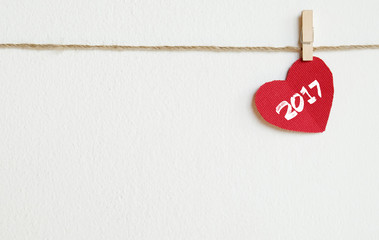 Red fabric heart with 2017 word hanging on the clothesline
