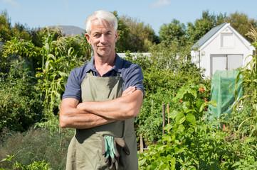 Satisfied farmer in garden