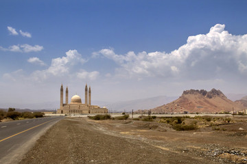 Great mosque of Nizwa and rocky mountains