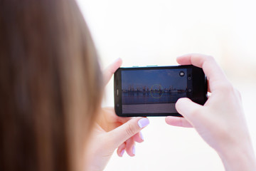 Cropped shot view of a woman's hands making photo with mobile phone