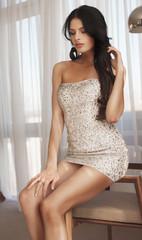 Sexy brunette woman in little fashion dress