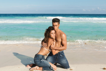 Couple in embrace on the beach