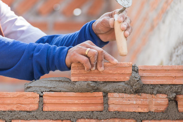 Bricklayer working in construction site