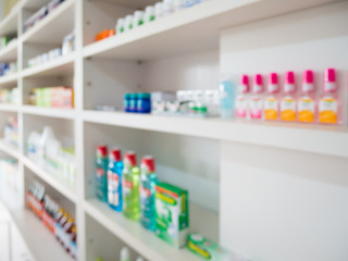 Close up of medicine bottles on shelves of drugs in the pharmacy