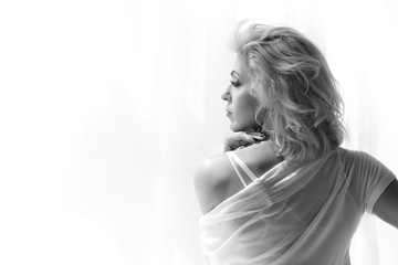 Portrait of adult blonde woman looking at window