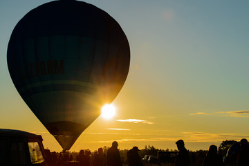 image of blur hot air ballooning silhouettes in the sunset