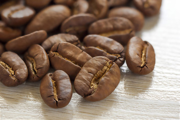 Broun coffee beans isolated on textured wooden  background with