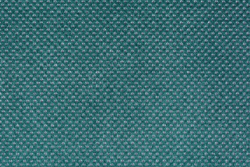 Turquoise fabric with round grey inclusions
