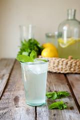 Cold homemade  lemonade with lemon and mint