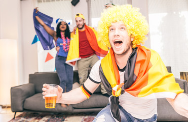 German supporter watching match at home
