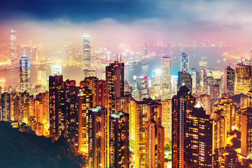 Scenic view over Hong-Kong, China, by night. Nighttime skyline with illuminated skyscrapers seen from Victoria Peak.