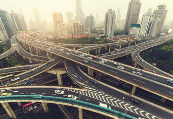 Big highway junction in Shanghai, China with traffic. Famous landmark of Shanghai in the evening.