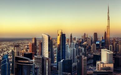 Fantastic Dubai towers at sunset. Skyline.