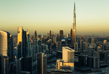 Downtown Dubai with skyscrapers. Aerial view over the famous architecture of Dubai at sunset.