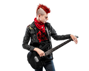 Portrait of teen boy with red haired Mohawk and guitar in leather jacket.Isolated.