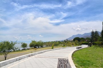 Paved pedestrian road along Chapala lake on a sunny day