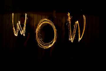 The word Wow in sparklers time lapse photography