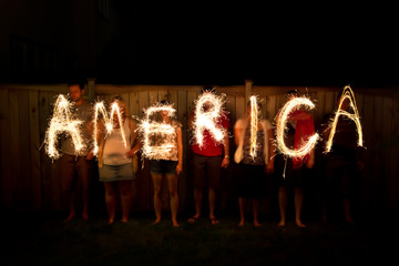 The word America in sparklers as part of Independance Day (July