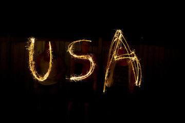The word USA in sparklers as part of Independance Day (July 4th)