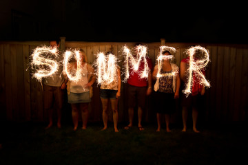 The word Summer in sparklers time lapse photography