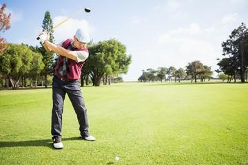 Golfer raising his golf club