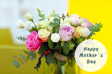 Happy Mothers Day. Vase with fresh roses on wall background