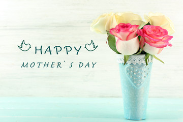 Happy Mothers Day. Beautiful bouquet of roses on light wooden background
