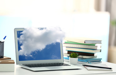 Laptop on the table in the office. Cloud storage concept