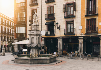 Old square with fountain in Madrid. Spain