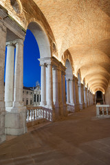 Night view of the columns and arches of the Palladian Basilica in Vicenza