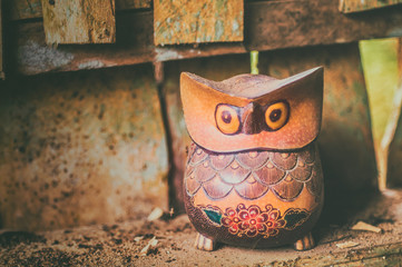 Copyrighted free image of dusty wooden owl sculpture decorate with hand written batik ornament