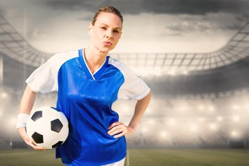 Composite image of portrait of woman football player is posing