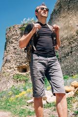 Tourist walk on the castle ruin territory