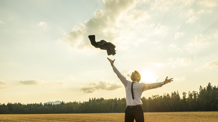 Happy Successful Businessman Throwing His Coat in the Air