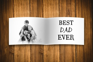 Composite image of fathers day gift and family picture