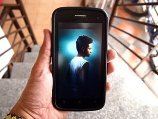 Photo of a kid displayed on a smartphone