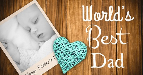 Composite image of sleeping baby and fathers day word