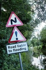 road side flooded sign
