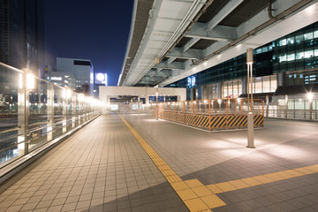 modern office buildings in downtown of tokyo at night