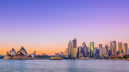 Sydney city skyline at sunrise with vivid coloured sky.