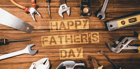 Happy fathers day message surrounded by tools