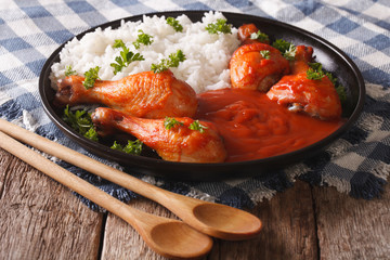 Baked chicken with chilli sauce Sriracha and Rice close-up. horizontal