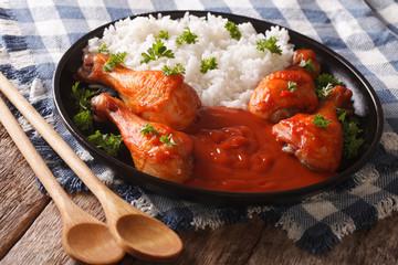 Thai dish: chicken with chilli sauce Sriracha and Rice close-up. horizontal