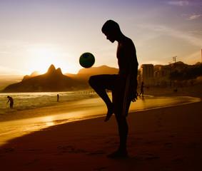 Soccer player at beach at Rio de Janeiro