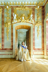 Historical cosplay. Beautiful woman in the similitude of Catherine the Great, empress of Russia ancient dress in the palace