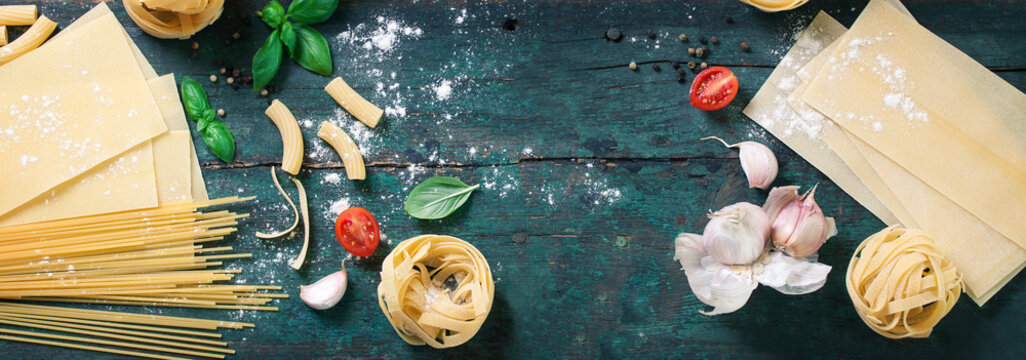 Italian food background with different types of pasta, health or vegetarian concept. Top view with copy space, toned