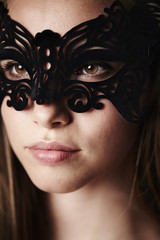 Beautiful woman in mask, close up