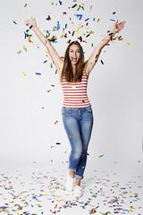 Beautiful woman celebrating good times in studio