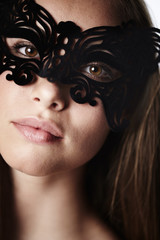 Stunning beauty in masquerade mask, portrait